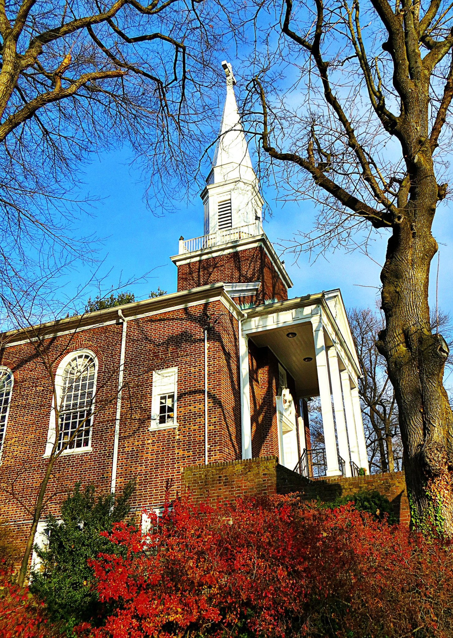 EastFallsLocal Pres church with red foliage
