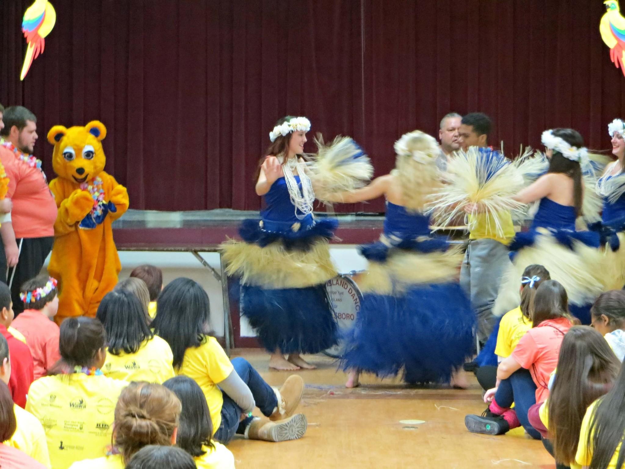 East Falls Local -- polynesian dancing close motion blur